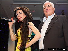 Mitch Winehouse with the waxwork model of his daughter