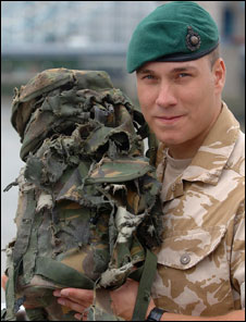 L/Cpl Matthew Croucher with his ripped backpack