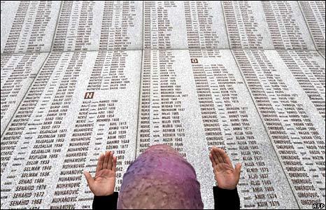 A Bosniak woman near Srebrenica prays at a memorial
