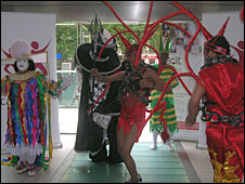 Dancers wearing the costume at the launch