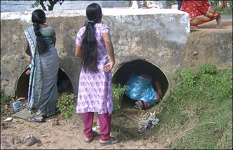 Teachers take shelter in drains.