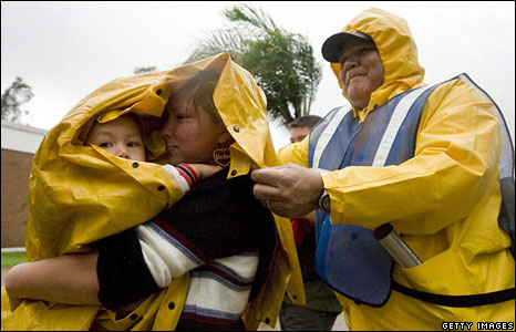 Evacuees are ushered to a shelter in Brownsville, Texas, 23 July 2008