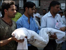A body being carried away from the scene of the blast