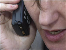 Woman makes mobile phone call