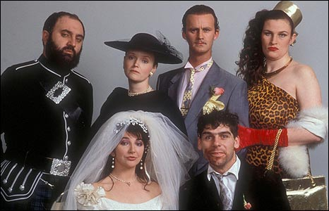 Kate Bush and the cast of The Comic Strip presents in 1990