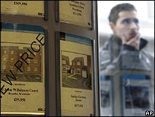 Man looking through estate agent's window in Wrexham, Wales