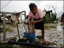 File image of a woman washing clothes in a refugee camp in East Timor
