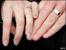 Couple showing wedding rings (file pic)
