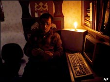 A man reads in candle-light in India