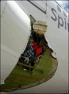 The gaping hole in the fuselage of the  Boeing 747 at Manila airport