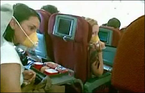 Passengers aboard the Qantas plane wear oxygen masks as it comes in to land in Manila