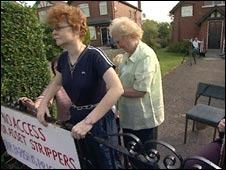 Parishioners start to chain themselves to the church gates