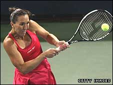 Jelena Jankovic plays a backhand in her win over Nadia Petrova