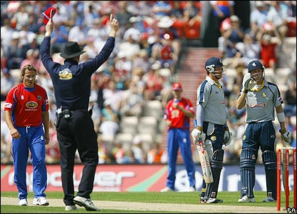 The umpire signals six after Joe Denly's effort