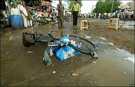 A cycle lies at the site of a blast in Ahmedabad, Gujarat, on Saturday