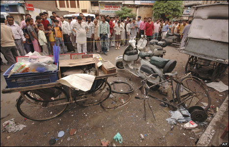 People look at the site of an explosion in Ahmadabad