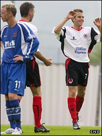 Alan Trouten celebrates scoring against Annan