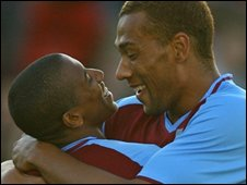 Ashley Young and John Carew
