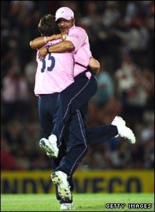 Murali Karthik hugs Tyron Henderson