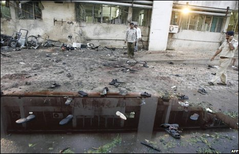 Shoes in a puddle outside a hospital targeted by the bombers