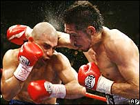 Mexican Antonio Margarito (right) unloads punches on Miguel Cotto