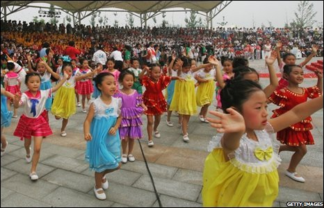 Chinese children perform during the opening ceremony