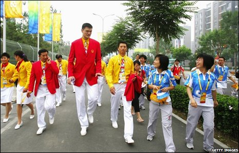 China's NBA star Yao Ming (C) leaves after attending the opening ceremony of the Olympic Village