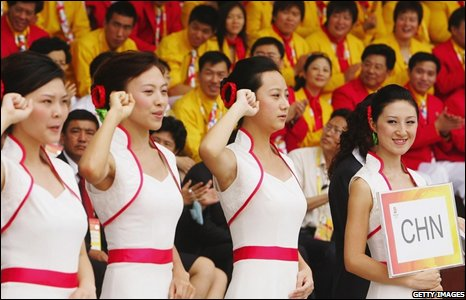 Chinese volunteers take oath during the opening ceremony