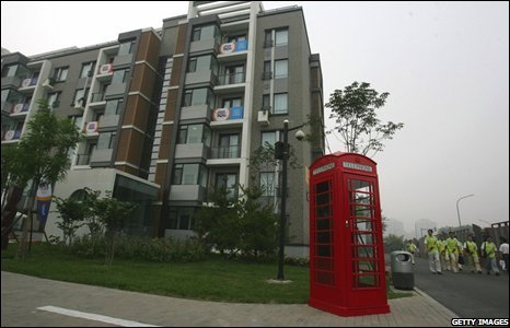 A British red phone booth is installed at the Great Britain section of the Olympic Village