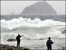 Fishermen brave the wind and waves of approaching Typhoon Fung-Wong in Keelung, Taiwan