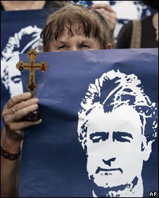A woman holds a picture of Radovan Karadzic during a protest in Belgrade, Serbia