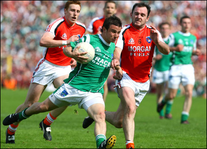 Shane McCabe bursts away from Aidan O'Rourke