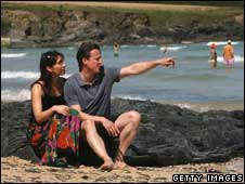 Samantha and David Cameron on beach