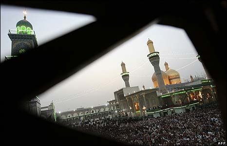 Crowds of pilgrims at prayer in the Musa al-Kadhim shrine