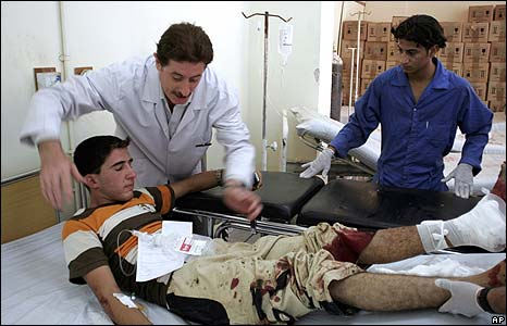 An Iraqi youth is treated in hospital for injuries