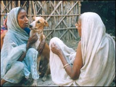 Chhotu with his owner Rajkumari Devi - right, with her back to camera (Photo: Dilip Raj)