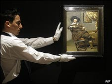 Sotheby's employee holding Frans Hals' Portrait of Willem van Heythuysen which sold for 7m at auction last month