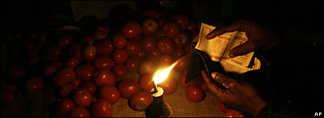 A man buys tomatoes for Z$20bn each in Harare, 23 July 2008
