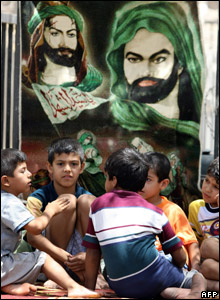 Children rest next to a rug bearing the portrait of Imam Hussain
