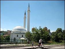 The mosque (left) standing beside the Serbian Orthodox church (right) in central Urosevac