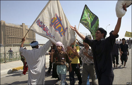 Shia Muslim pilgrims chant as they cross the Euphrates River on their way to the Musa al-Kadhim Shrine