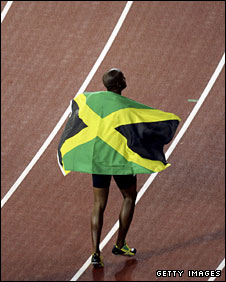 Asafa Powell celebrates his 100m win at the 2006 Commonwealths