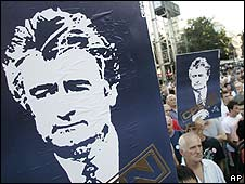 Supporters of Radovan Karadzic hold up posters of him during a protest in Belgrade, Serbia (28 July 2008)