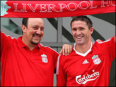 Liverpool striker Robbie Keane (right) with boss Rafael Benitez