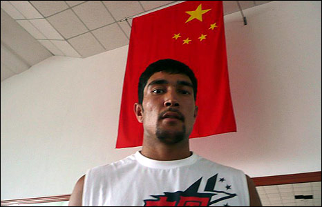 Mehmet Tursun Chong, pictured in front of a Chinese flag (Image: Hugh Sykes)