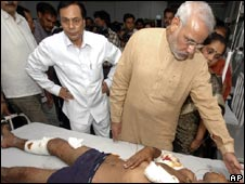 Chief Minister Narendra Modi visits the wounded in hospital