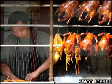 Cooked ducks in the window of a Chinese restaurant