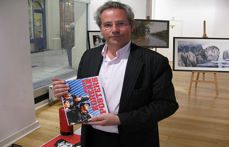 David Heather with book of North Korean posters