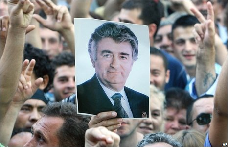 Protester holding a photograph of Radovan Karadzic