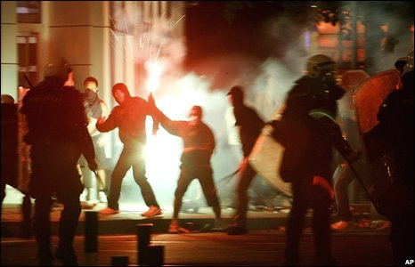 Rioters holding flares in Belgrade